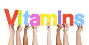31299134 - diverse hands holding the word vitamins